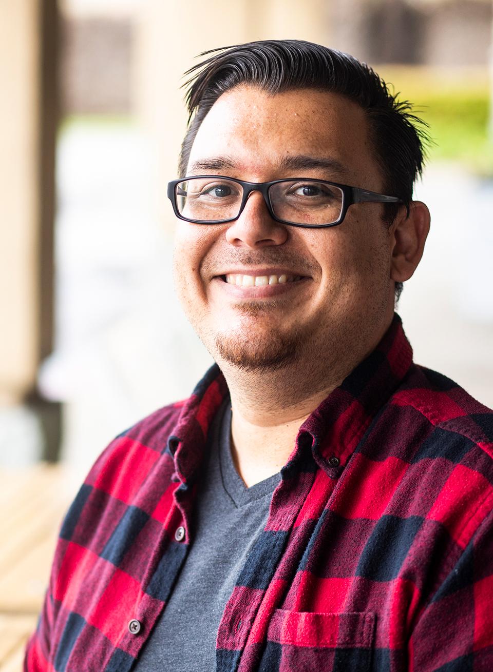 Smiling latino male student